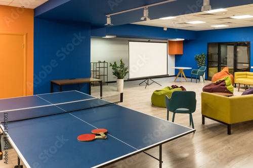 Ping pong tennis at modern creative office space