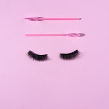 Creative Concept Beauty Fashion Photo Of Lashes Extensions Brush On Pink Background.