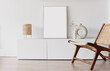 canvas print picture - Blank picture frame mockup on white wall. White living room design. View of modern scandinavian style interior with chair. Home staging and minimalism concept