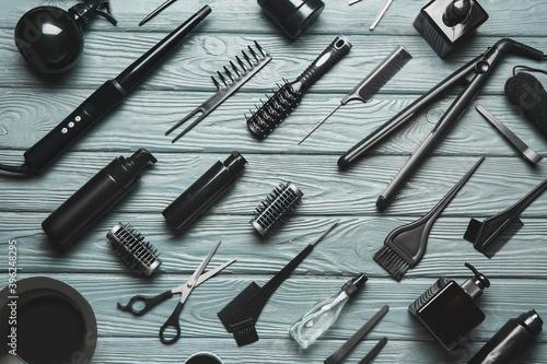 Fototapeta Set of hairdresser's tools on wooden background obraz