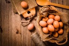 Organic Eggs On Wooden Backgro...