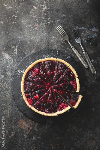 Fototapeta Fresh cheesecake with berry jam