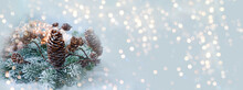 Christmas Winter Background - Banner With Pastel Blue Soft Frame With Pine Cones And Bokeh Lights