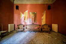 Living Room With Sofa And Armchairs In Old Abandoned House