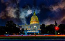 The United States Capitol Building With The Dome Lit Up At Moon In The Dark Sky