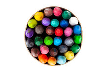 A Cylindrical Carton Tube Full Of Colorful Wax Crayons Seen From Above, Top View. Lots Of Multi Colored Crayons, Object Isolated On White, Cut Out. Education, Back To School Concept, Graphical Element