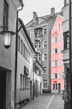 Old Pink Building In Salzburg Street, Vintage Building On Cobblestone Street In The Old Town. Black And White Toned. Austria