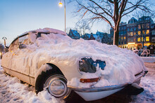 Classic Car Covered With Snow On A Winter Day During Sunset In Amsterdam