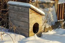 Booth For A Dog In A Siberian Village In Winter. Countryside Yard On A Sunny Day.