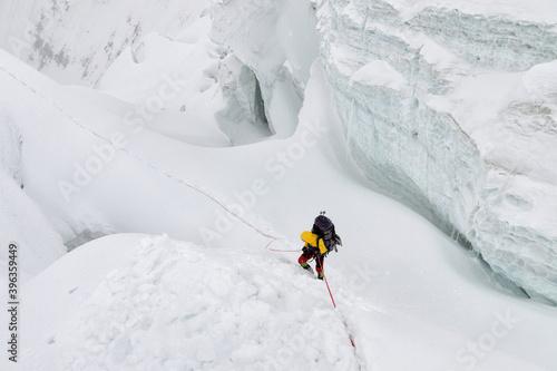 Obraz na plátně Mountain climber climb seracs (glacier)
