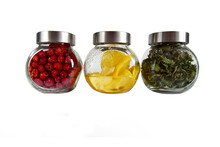 Foods In Glass Jars On White Background Rose Hips, Lemon And Mint Berries, Healthy Food And Diet Concept