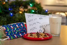 Milk, Cookies And Covid 19 Masks Left By Small Child For Santa Claus