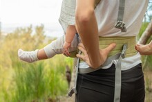 A Active Mother With Her Baby Outdoor. Postpartum Health And Wellness.
