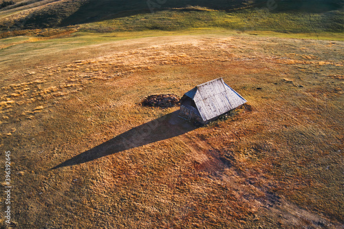 Traditional cowherds's cottage on pasture field on mount Zlatibor in Serbia Poster Mural XXL