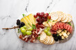 canvas print picture Charcuterie board with variety of cheese and meats
