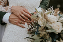 Hands Of Bride And Groom On A Wedding