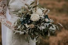 Boho Bride Holding Vintage Bouquet With White Roses And Eukalyptus