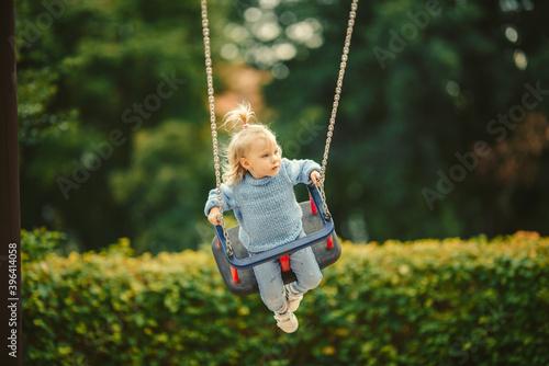 Obraz blonde haired girl on the swing - fototapety do salonu