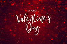 Happy Valentine's Day Text Over Luxurious Red Sparkle Glitter Background, Glamorous Valentine Holiday Calligraphy Font With Glowing Defocused Bokeh Lights Backdrop, Elegant Valentine's Day Card Design