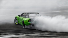 Blurred Car Drifting, Professional Driver Drive Car Drifting On Asphalt Street Road Race Track, Automobile Or Automotive Drift Car With Lot Of Smoke From Burning Tire On Speed Track.
