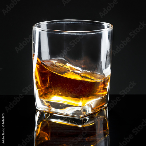 Obraz na plátně Whiskey served neat in a glass