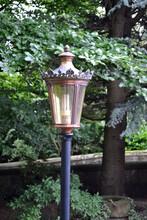 Ornate Traditional Lantern On Pole In Public Garden