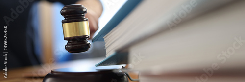 Fototapeta Wooden gavel for judge on table next to folder with documents