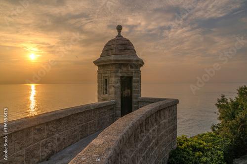 Obraz na plátně Lever de soleil sur le fort saint Antoine en Principauté de Monaco