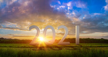 New Year 2021 Or Start Straight Concept.3D Word 2021 On The Field In At Sunset.Concept Of Planning And Challenge Or Career Path,business Strategy,opportunity And Change,start Up.