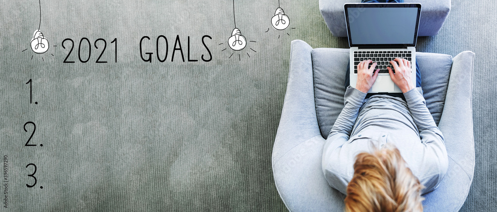 Fototapeta 2021 goals with man using a laptop in a modern gray chair