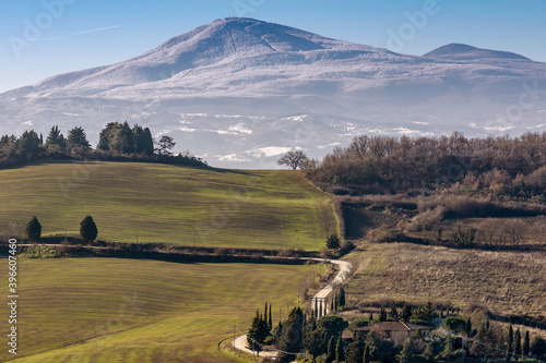 Fototapeta premium Beautiful panoramic view of Monte Amiata covered with snow from Monticchiello, Siena, Tuscany, Italy
