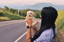 Young Woman Holding An Adorable French Poodle Mini Puppy