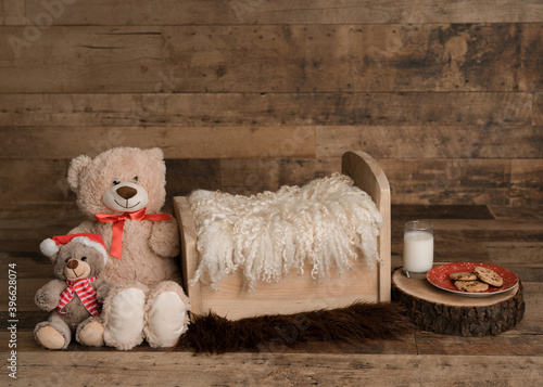 Fototapeta Newborn digital backdrop, rustic Christmas theme, with Teddy bear, milk and cookies for Santa, and brown backdrop. obraz