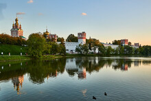 Russia. Moscow. Novodevichy Convent Behind The Big Novodevichy Pond After Sunset