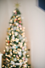 Defocused View Of Illuminated Christmas Tree At Home
