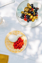 Overhead View Of Goji Berries And Pickled Olives Served On Table
