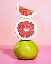 Close Up Of Stack Of Grapefruits On Table