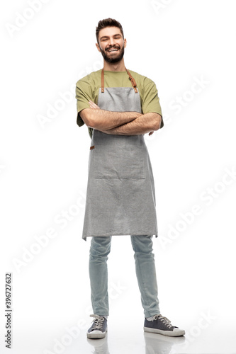 Fototapeta people, profession and job concept - happy smiling barman in apron with crossed