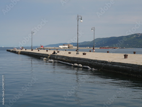 Molo Audace pier in Trieste, a walkway built by stones and extending over the Ad Fotobehang