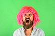 Leinwandbild Motiv Angry man portrait. Man in color wig. Angry man. Brutal bearded man. Portrait of serious men. Isolated. Scream. Angry. Emotions.