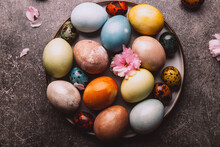 Easter Eggs Dyed In Pastel Colors With Natural Ingredients From Red Cabbage, Onion, Spinach, Berries, Turmeric, Coffee. Homemade Naturally Dyed Eggs.