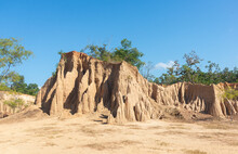 Sao Din Na Noi At Sri Nan National Park In Nan Province, Thailand. The Condition Of The Earth Rod Mixed With The Eroded Reddish-orange Rock Has A Streaky Condition Against A Blue Sky Background.