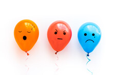 Negative Emotions Painted On Ballon. Angry Sad Mood Background. Top View