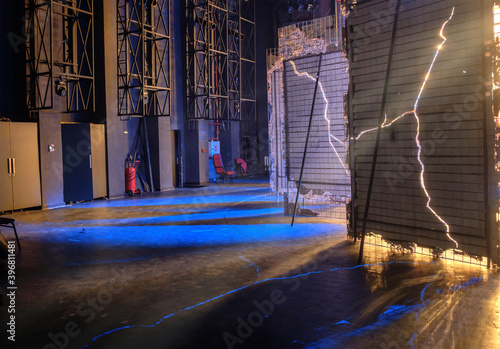 Foto View from  the backstage of a theater, a blue lights brakes through the decorati