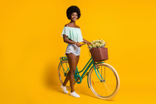 Photo Portrait Full Body View Of Girl Leading Bike Isolated On Vivid Yellow Colored Background