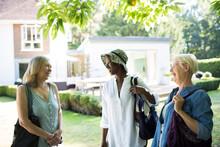 Happy Senior Women Friends Talking In Sunny Summer Garden