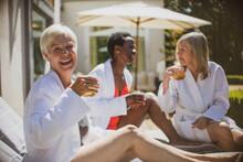 Portrait Happy Senior Women Friends Relaxing On Sunny Hotel Patio