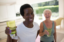 Portrait Confident Senior Women Friends Drinking Water After Workout