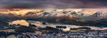 Panoramic View Of Derwentwater In The Lake District On A Winter Morning With Snow On Mountains.