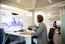 Businesswomen On Video Conferencing Call In Office